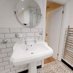 Withe Bathroom Suite and metro tiles on the walls